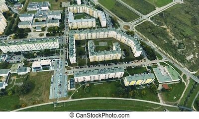 Apartment buildings and car parks, aerial view. Banska...