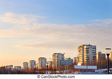 Apartment buildings in residential quarter of city at sunset