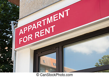 Apartment for rent sign on modern building in city