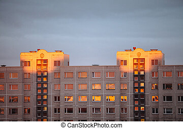 Apartment house in the rays of sunset