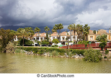 Apartment houses along the Green River (Spanish: Rio Verde) in Marbella, southern Andulasia, Spain.