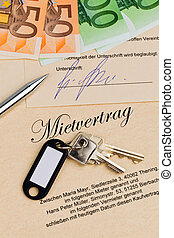 Apartment keys and rental agreement - The key to an...