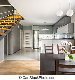 Apartment with stairs and dining table
