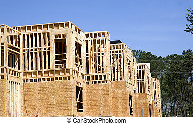 An apartment complex under new construction with wood