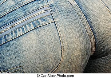 apertado, calças brim azuis