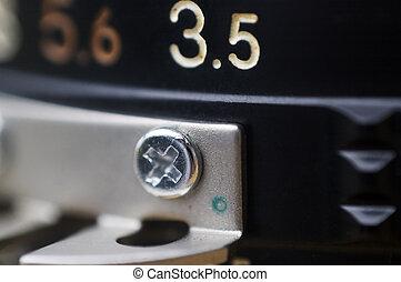 Aperture 3.5 - Macro shot of a camera lens focusing on the ...