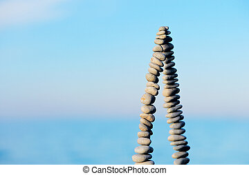 Apex - Pile of pebbles as pyramid against the background of...