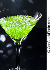 Apple Martini cocktail in front of disco lights