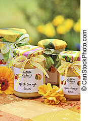 Apple-orange curd on a colorful tablecloth in the garden