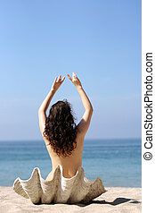 Aphrodite - Girl in sea shell on the beach