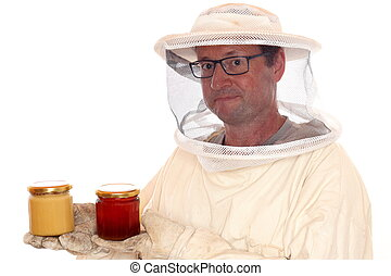apiarist with honey glasses in hands