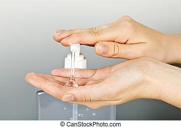 aplicando, mãos, sanitizer, gel