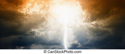 Apocalyptic background - sun, lightning and clouds in dramatic dark sky. End of time. Bible armageddon.