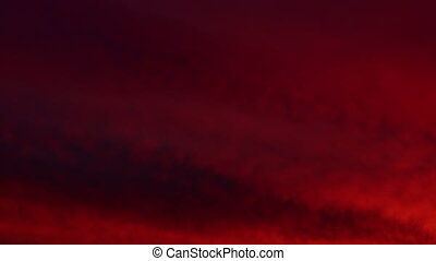 Apocalyptic red sky with  clouds. Dramatic red sky clouds