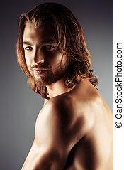 Apollo man - Portrait of a sexual muscular nude man posing...