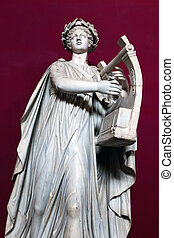 Apollo wearing a wreath of laurel and strumming a lyre