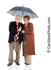 aposentado par, guarda-chuva, sob