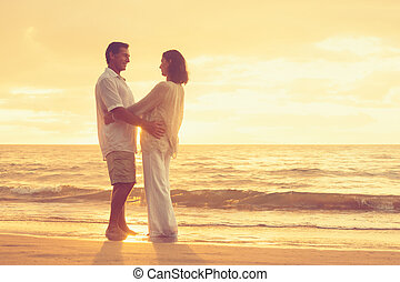 aposentado par, praia