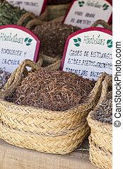 Apothecary, wicker baskets stuffed medicinal healing herbs
