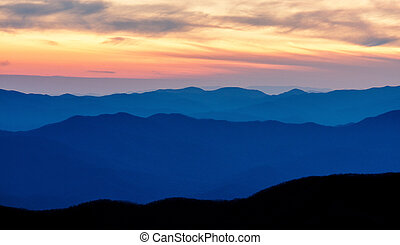 Appalachian Mountains in shadows during sunrise.