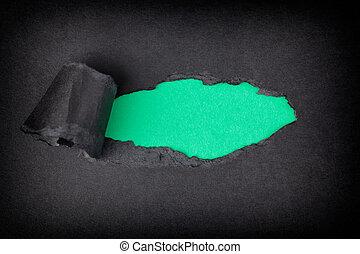 apparaître, déchiré, derrière, papier, arrière-plan vert, noir
