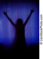 ghost woman black silhouette behind blue curtain