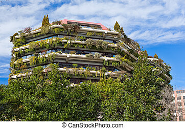 Appartment building covered by climbing plant - creeper