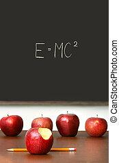 appeltjes , bovenop, schoolbank