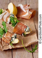 Appetizer. - Apple ham cheese appetizer with arugula on a...
