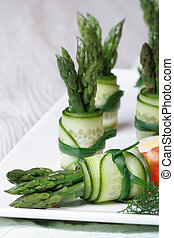 Appetizer buffet: beautiful cucumber rolls with asparagus