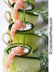 appetizer buffet: cucumber rolls with shrimp vertical macro