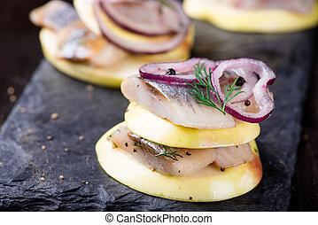 Appetizer canape with herring, apples