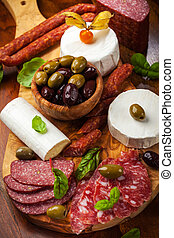 Appetizer catering platter with different meat and cheese products