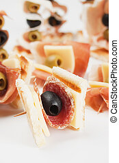 Appetizer food with salami and black olive