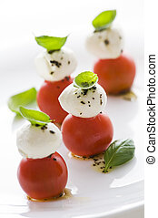 Fresh basil, tomato and mozzarella appetizer close up