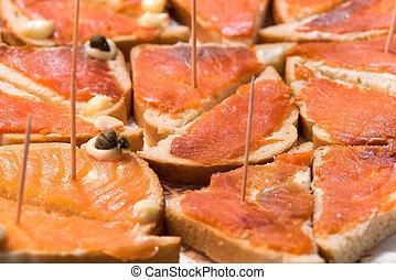 Appetizer of salmon tartlets