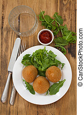 appetizer on white plate on brown background