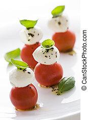 Appetizer - Fresh basil, tomato and mozzarella appetizer...