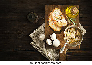 Appetizer with mushroom and bread.