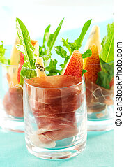 appetizer with pear, prosciutto, arugula, Gorgonzola in ...