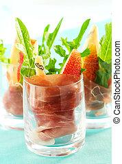 appetizer with pear,prosciutto,arugula,Gorgonzola in glasses