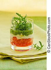 appetizer with tomato, cheese and pesto in glasses
