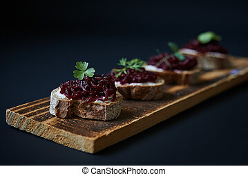 open sanswiches with beetroot on wooden board