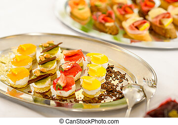 Appetizers mini desserts on catering buffet plate -...