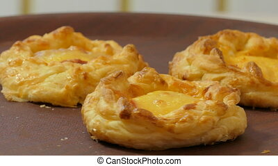 appetizing baked pies on a rotating plate, close-up