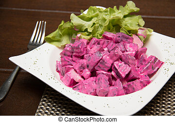 beetroot salad in a white bowl