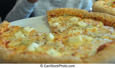 Appetizing cheese pizza - Close-up shot of a woman taking a...