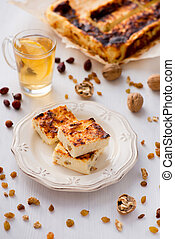 Appetizing cottage cheese pie with raisins