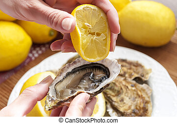 oysters - appetizing French oysters with lemon, delicious, ...