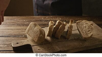 Appetizing fresh crispy sliced bread baker throws on a...